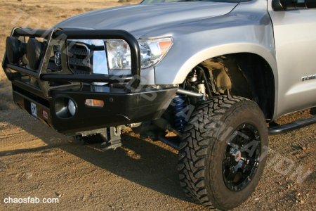 Fiberglass front fenders are required with the Total Chaos long travel kit.