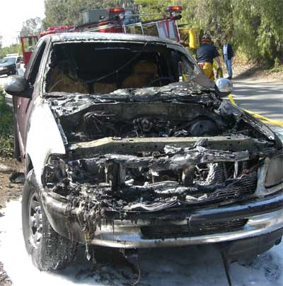 This F150 caught fire when an ejected spark plug hit a fuel line. Image from ConsumerAffairs.com