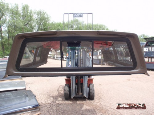 Topper front window that slides and flips