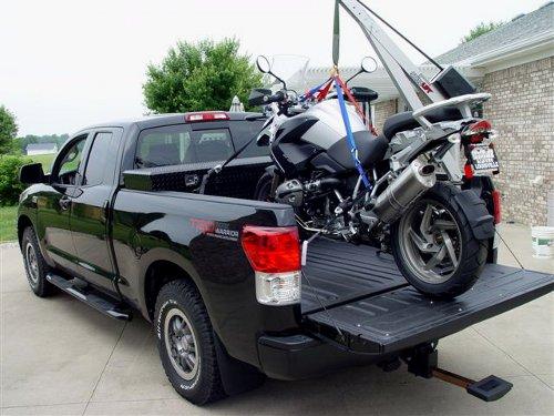 Tundra with Spitzlift crane holding BMW motorcycle