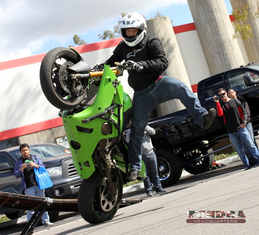 Sportbike standing on one leg wheelie