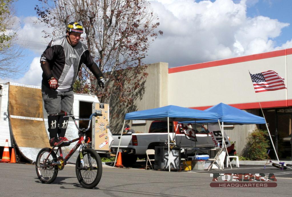 Standing BMX rider no hands