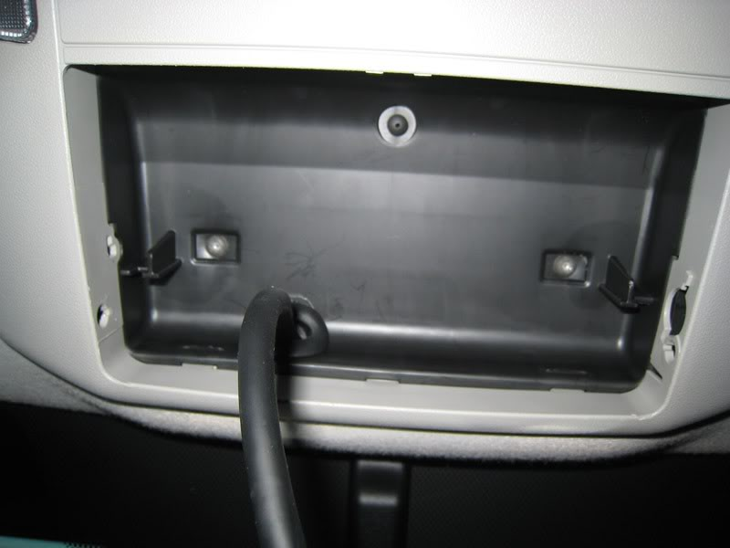 Step 11: Remove the back-up camera housing to access the last 2 screws