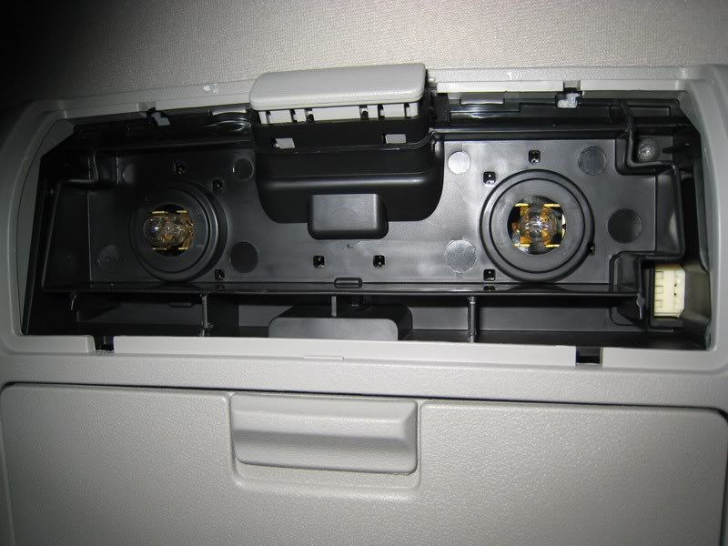 Step 9: Remove the overhead consoling by removing the 6 screws.