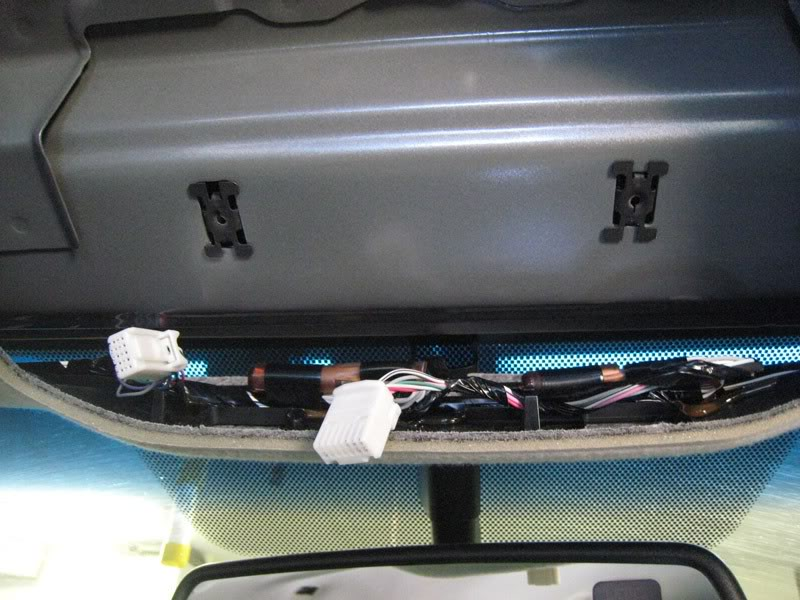 Step 12: Unplug the wiring harness and remove the overhead console