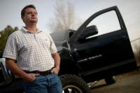 Gil Sanders stands next to his 2003 Dodge Ram 2500 pickup. He wants to smash it, but needs it for evidence. (Photo by Hyoung Chang/The Denver Post)