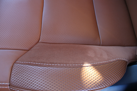 The seats have a soft, suede like leather along with a slick. It just works.